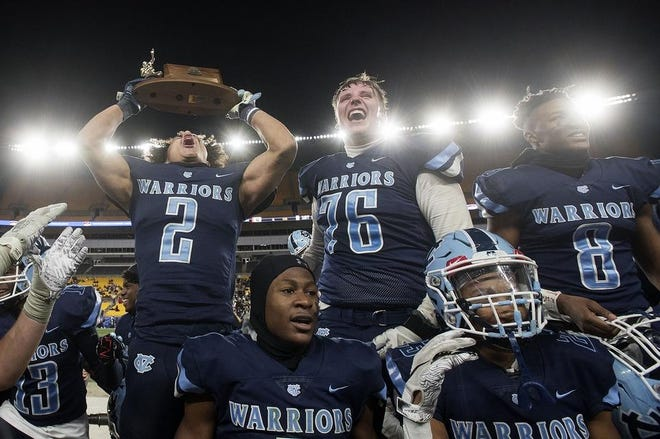 Central Valley players lift the WPIAL trophy after defeating Aliquippa in the WPIAL Class 3A championship last November. The PIAA finalized its playoff structure Wednesday, which will enable the WPIAL to formalize its own plans. It's unlikely the WPIAL championships will be at Heinz Field in 2020.