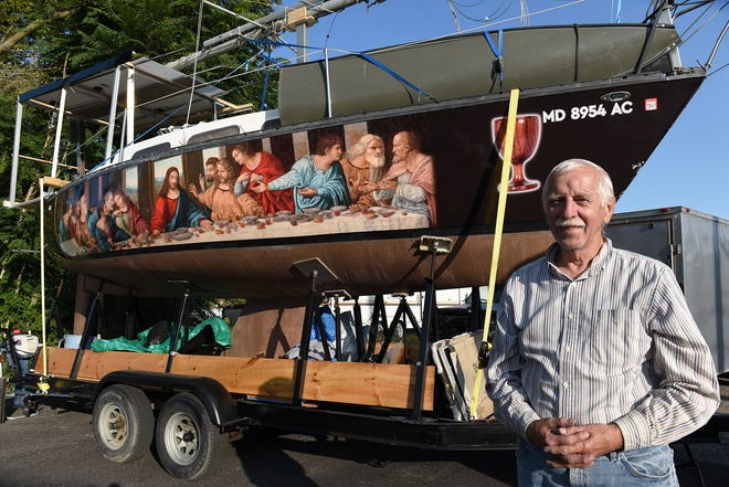 "Wolfgang Michael Dunker's sailboat has turned plenty of heads in Bridgewater because of a reproduction of Leonardo da Vinci's masterpiece ""The Last Supper"" decorating both sides."