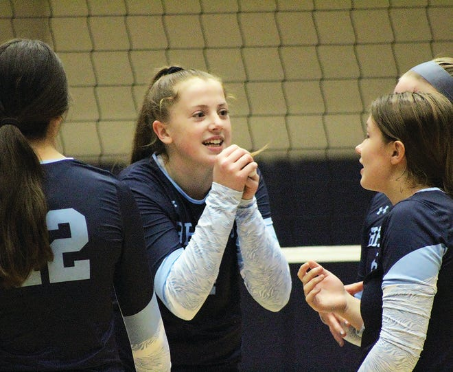 Freshman Kelsey Ward, center, celebrates with her varsity teammates following a scoring play early in the Bartlesville High School varsity volleyball season.