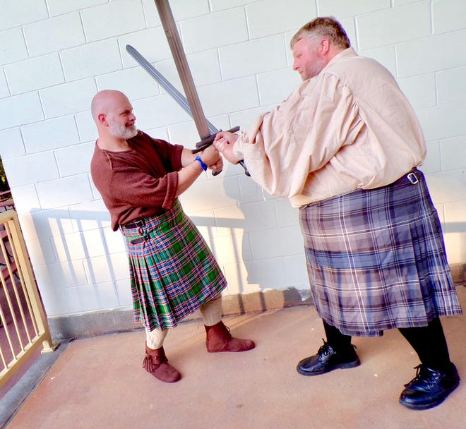 Josh McFarland as Macbeth, left, duels it out with Josh Tuel, who plays Macduff.