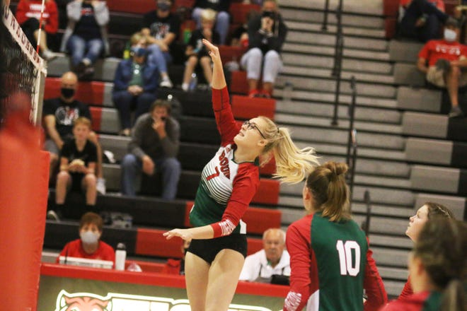 Senior Lily Spurgeon with a spike on Tuesday, Sept. 22 against ADM.