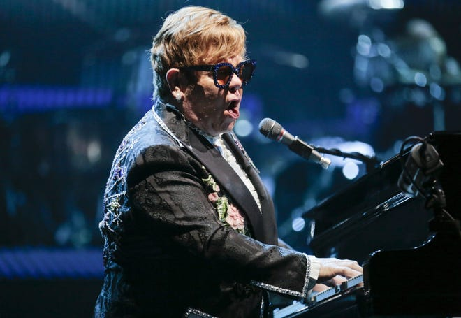 Elton John performs in 2018 at Value City Arena. The iconic singer will return in 2022 after rescheduling his postponed farewell tour.