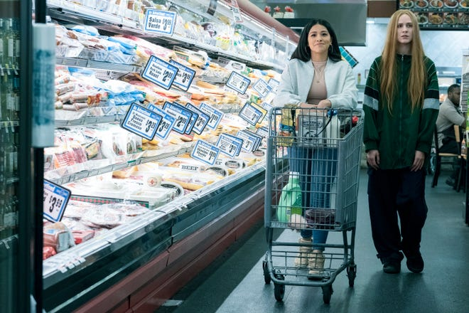 """Evan Rachel Wood, right, with Gina Rodriguez in a scene from """"Kajillionaire."""""""
