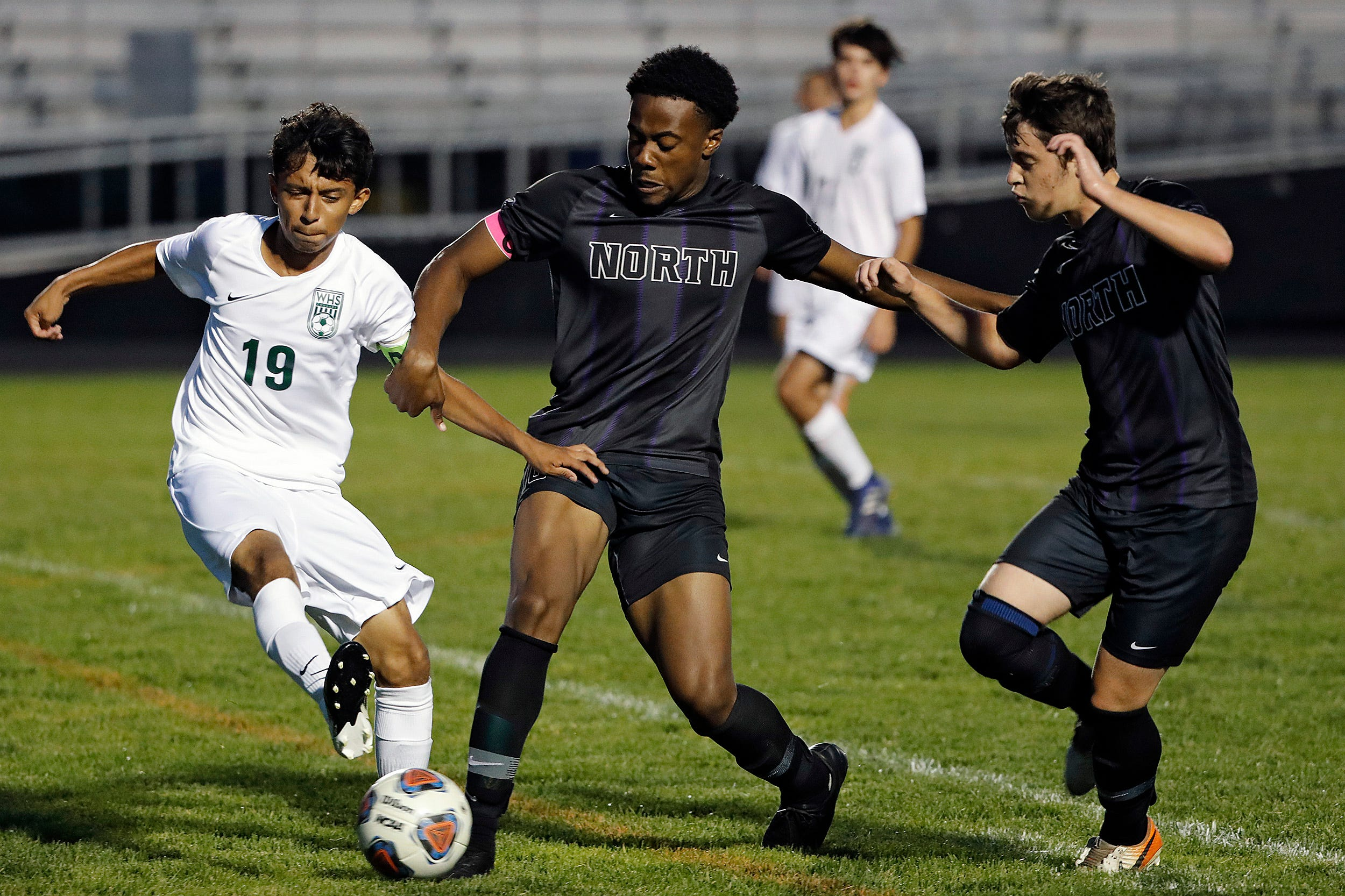 Pickerington North's Uche Odemena (10) battles for the ball with Westland's Pato Rebollar (19) during the 1st half of their game at Pickerington High School North on Sept. 22, 2020.