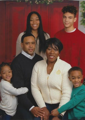 The Harris family in 2017: center, parents Chris and Angel Harris; bottom, from left, Angelina Harris, who was diagnosed with leukemia at age 3, and her younger brother, Josh Harris; top, from left, Alexis Wilson and Elon Harris. [Provided family photo]
