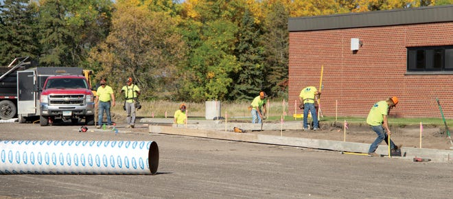Work continues on a project at the Crookston National Guard Armory that includes new paving in the parking lot, new sidewalks and new exterior lighting.
