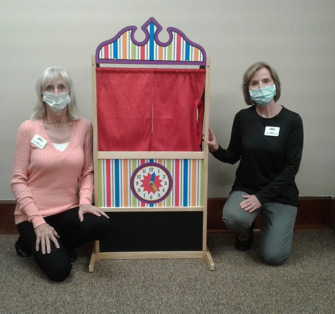 Penny Shepherd, LPCC-S, OHHS and Melissa Huff, LPCC-S, OHHS with puppet stage purchased through Gulfport Energy Fund.