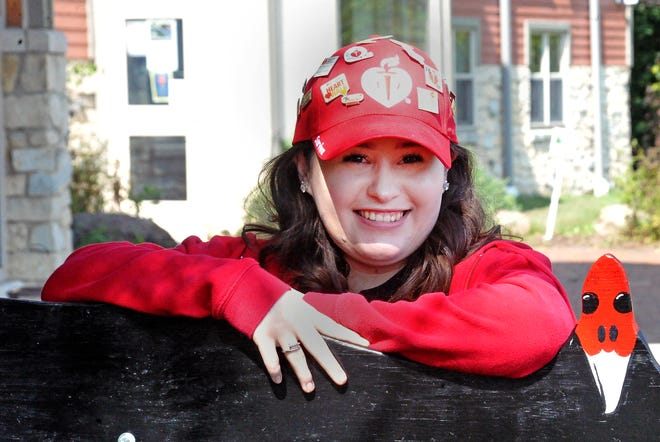 Julia Lendon, 19, of Mount Hope, is a congenital heart disease survivor. This year will be her 20th year participating in the annual Wayne Heart Walk. She dons a red Heart Walk hat complete with pins from each walk she participated in.