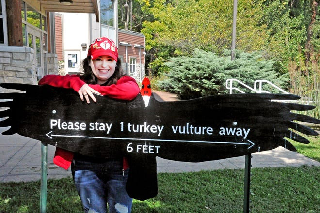 Julia Lendon, 19, of Mount Hope, is a congenital heart disease survivor. She stands by a social distancing sign at The Wilderness Center near Mount Eaton where she and her family plan to go Thursday to participate in the virtual Wayne Heart Walk.