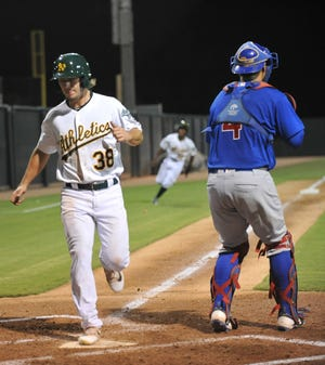 Austin Beck scores a run during an AZL A's rookie league game in 2017. [Mike Duprez/The Dispatch]