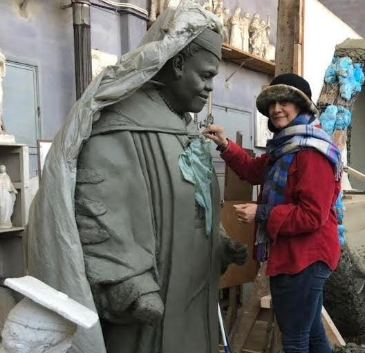 Master sculptor Nilda Comas, who has art studios in both Fort Lauderdale and Italy, has been chosen to create a statue of Mary McLeod Bethune that will stand in the Capitol in Washington, D.C. Comas is pictured with a model she made to prepare for the sculpture she'll create from a large block of marble taken from a Tuscan quarry.