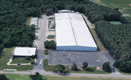Aerial view of the former paint factory near Cheswold at 1886 Lynnbury Woods Road.