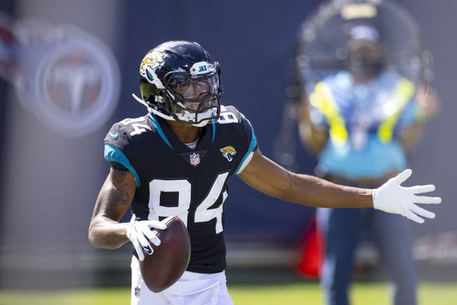 Jaguars wide receiver Keelan Cole (84) celebrates a touchdown reception during the fourth quarter of an NFL football game against the Tennessee Titans. Brett Carlsen/AP Photo