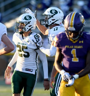 Central Catholic's Matt Kling (25) is congratulated by teammate Aaron Fox after making a field goal in Week 4 against Jackson.