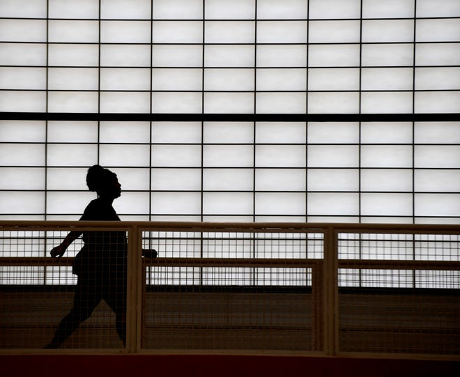 A patron uses the walking track inside the Massillon Recreation Center.
