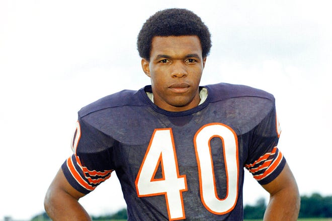 "This 1970 file photo shows Chicago Bears football player Gale Sayers. The Hall of Famer, who made his mark as one of the NFL's best all-purpose running backs and was later celebrated for his enduring friendship with a Chicago Bears teammate with cancer, has died. He was 77. Nicknamed ""The Kansas Comet"" and considered among the best open-field runners the game has ever seen, Sayers died Wednesday, Sept. 23, 2020, according to the Pro Football Hall of Fame."