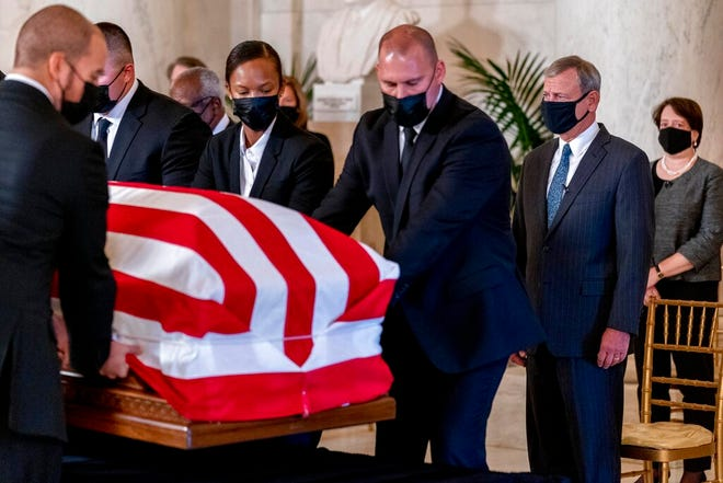 Chief Justice of the United States John Roberts, second from right, and Justice Elena Kagan, right, watch as the flag-draped casket of Justice Ruth Bader Ginsburg arrives at the Supreme Court in Washington, Wednesday, Sept. 23, 2020. Ginsburg, 87, died of cancer on Sept. 18. At far right is Associate Justice Elena Kagan.