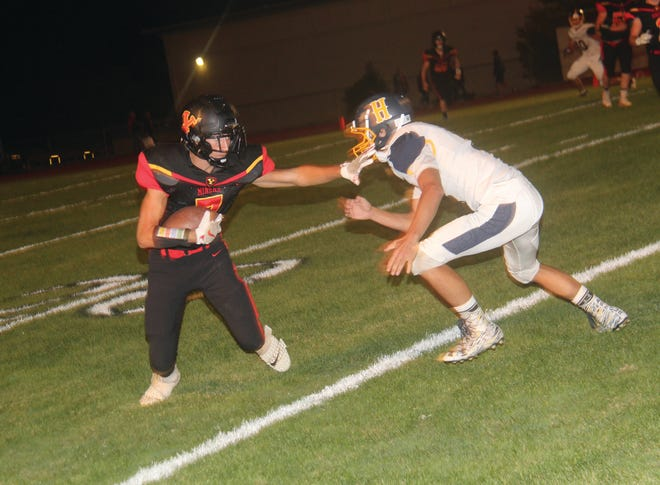 Miner Anthony Carrillo gains extra yards after a catch against Henley in 2019.