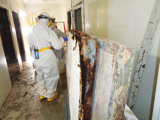 Crews in full protective gear have been conducting asbestos abatement inside remaining Biology Complex buildings at the Y-12 plant since early 2019.