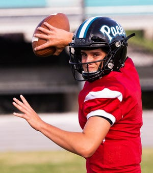 West Port's quarterback Gavin Savino prepares to throw during football practice Tuesday afternoon. The Wolf Pack are set to open their season against Belleview Friday night.