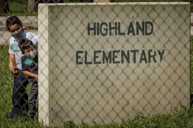 Highland Elementary School first-grade students in Laura Seaman's class play games on Sept. 23. Seaman teaches two classes with about half of her students attending virtually, she said.
