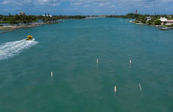 Signs in the middle of the Jupiter Inlet that warn boaters about extremely low depths in Jupiter, Florida on September 23, 2020. (Greg Lovett / The Palm Beach Post)
