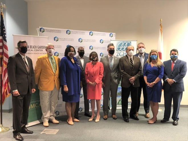 Palm Beach North Chamber of Commerce President and CEO  Noel Martinez (fifth from right) poses with elected officials from nine northern Palm Beach County municipalities Wednesday at the Business Before Hours Annual Mayors' Event at Palm Beach State College's Gardens campus.