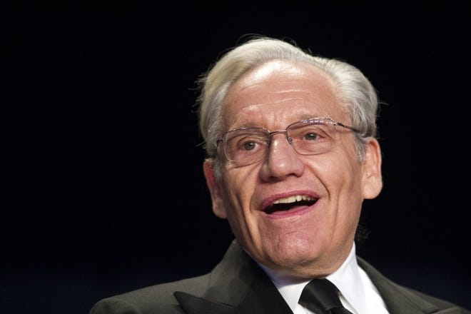 FILE - In this April 29, 2017, file photo journalist Bob Woodward sits at the head table during the White House Correspondents' Dinner in Washington. Woodward, facing widespread criticism for only now revealing President Donald Trump's early concerns about the severity of the coronavirus, told The Associated Press that he needed time to be sure that Trump's private comments from February were accurate. [AP Photo/Cliff Owen]