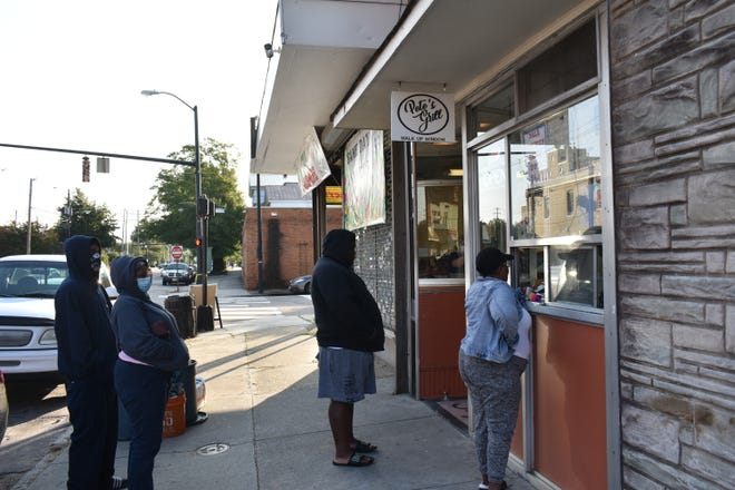The front window at Pete's Grill reopened to a steady flow of customers after six months of closure.