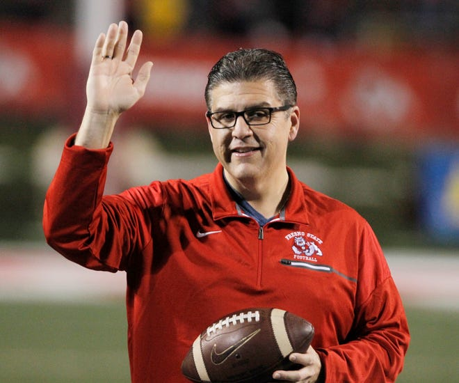 In this Nov. 4, 2017 file photo, Fresno State president Joseph I. Castro waves to the crowd before an NCAA college football game against BYU in Fresno, Calif. Castro was chosen to be the new chancellor of the California State University, becoming the first Mexican-American and native Californian to lead the nation's largest four-year public university system.