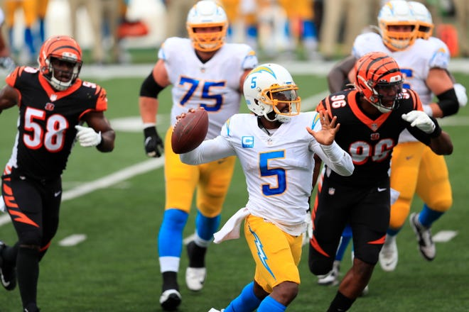 Los Angeles Chargers quarterback Tyrod Taylor (5) throws during the first half of the Chargers' season-opening win against the Cincinnati Bengals on Sept. 13 in Cincinnati.