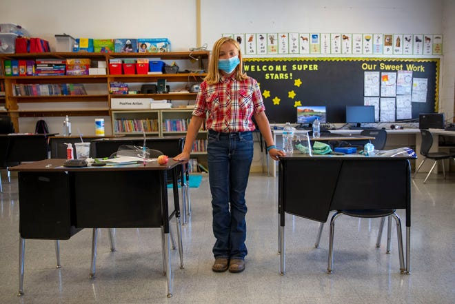"""Sixth grader Katie Newton in her classroom Sept. 2, 2020, in Spray, Oregon. Newton has been a Spray student her whole life. """"We actually get to go to school and, you know, we get to play outside and actually get to interact and stuff,"""" Newton said."""