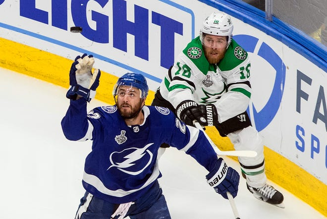 Tampa Bay's Kevin Shattenkirk (front) and Dallas' Joe Pavelski (16) battle for the puck during the third period of Monday's Stanley Cup finals game. The series is tied 1-1 entering Wednesday night's Game 3.
