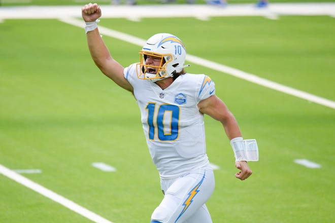 Los Angeles Chargers quarterback Justin Herbert celebrates his first career touchdown pass during Sunday's 23-20 overtime loss to the Kansas City Chiefs in Inglewood, Calif