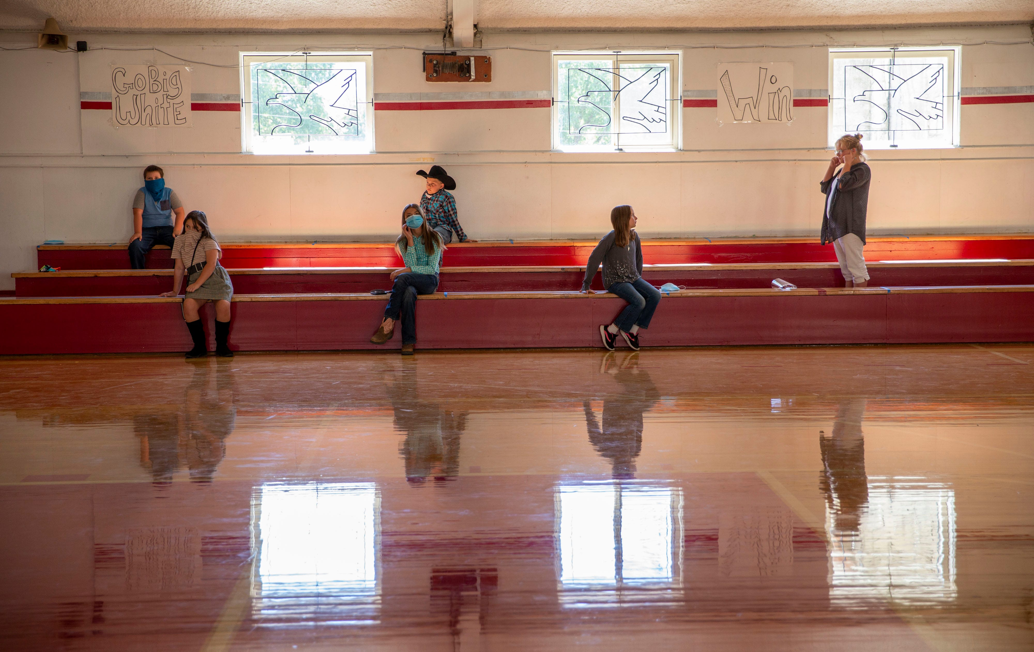 Students in the combined class of fourth, fifth and sixth graders at Spray School wait for their turn to take school pictures on Sept. 2, 2020, in Spray, Oregon. The 49 students in grades K-12 are attending in-person classes as are kids in the other two districts in  in Wheeler County.