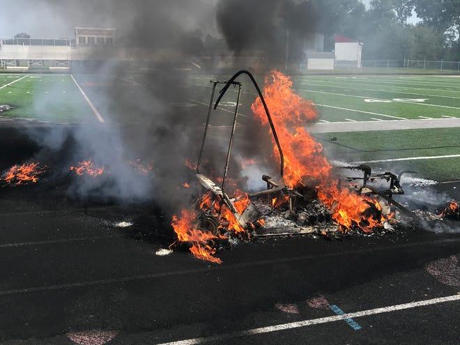 A golf cart carrying football equipment caught fire Wednesday inside Sandy Valley High School's football stadium.
