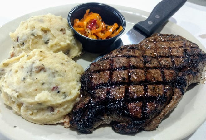 The 12-ounce hand-cut Ranch Hand Ribeye with marinated peppers and Mexican mashed potatoes at The Chop House in Carrollton.