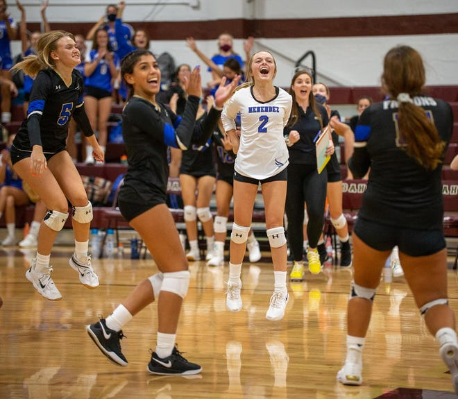 Menendez libero Andi Barbour celebrates the Falcons' 25-20, 18-25, 25-11, 25-19 win over St. Augustine on Tuesday night. Barbour finished with 11 digs and three aces.