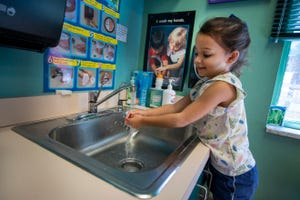 St. Mark's student Abigail Trinchet, 4, washes her hands before toy time on Thursday, Sept. 17, 2020 in Venice.