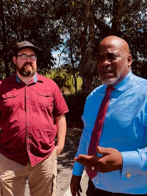 Neil Volz, deputy director of the Florida Rights Restoration Coalition, left, and Desmond Meade, president of the organization, both appeared Wednesday before Gov. Ron DeSantis and the Cabinet, sitting as the state Clemency Board.