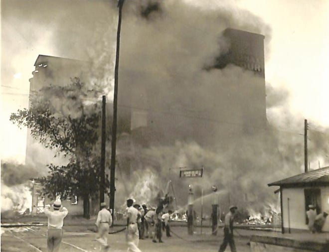 Many fighters and observers merged upon the scene of the August 11, 1934, fire at the Shawnee Milling Company.