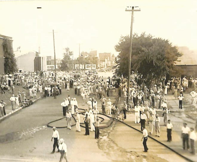 Hundreds of citizens converged upon the scene on south Broadway to observe this fateful event of the destruction of the Shawnee Milling Company.