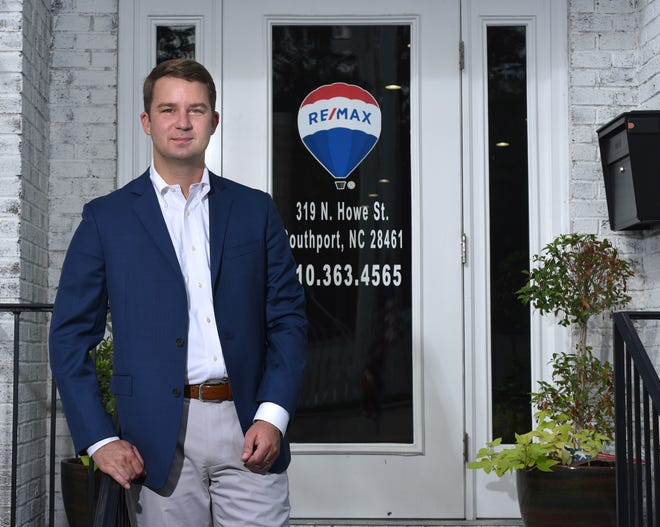 Robert Carroll, broker in charge and partner at RE/MAX Southern Coast stands in front of his office in Southport, N.C., Friday, Sept. 11, 2020. Carroll is one of the 40 Under 40 honorees for 2020.  [MATT BORN/STARNEWS]