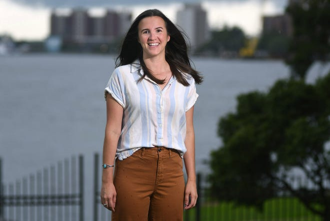 Lindsey Hallock, Director of Public and Environmental Policy at Cape Fear Public Utility Authority, stands with the Cape Fear River behind her in downtown Wilmington N.C., Wednesday, Aug. 19, 2020. Hallock is one of the 40 Under 40 honorees for 2020. [MATT BORN/STARNEWS]