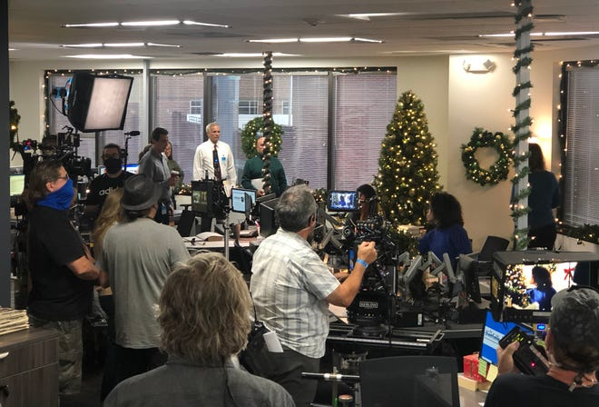 "Cast and crew of Hallmark's made-for-TV movie ""USS Christmas"" film a scene inside the StarNews newsroom in September 2020. [STARNEWS PHOTO]"