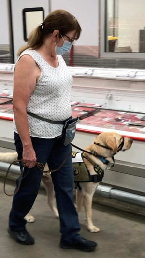 Rick and Pat Hairston with Four Paws and a Wake Up-NC announced the launch of a new program working with people and their own dogs to be trained as service dogs.