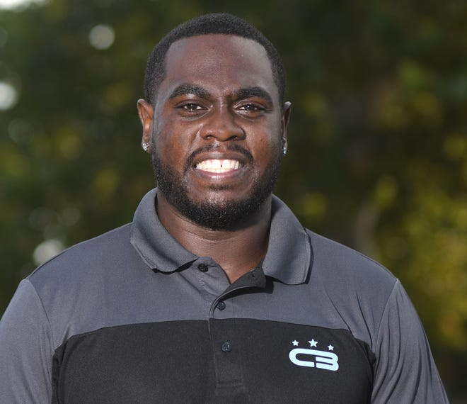 Cedric Boney, owner of CB Fitness and Athletic Training and The Youth League stands in Wrightsville Beach Park in Wrightsville Beach, N.C., Friday, July 31, 2020.  Boney is one of the 40 Under 40 honorees for 2020.