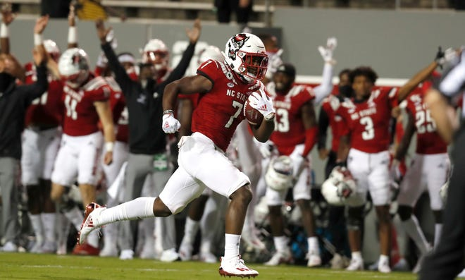 N.C. State running back Zonovan Knight (7) runs for a 30-yard touchdown during the first half of N.C. State's game against Wake Forest at Carter-Finley Stadium in Raleigh, N.C, Saturday, Sept. 19, 2020.