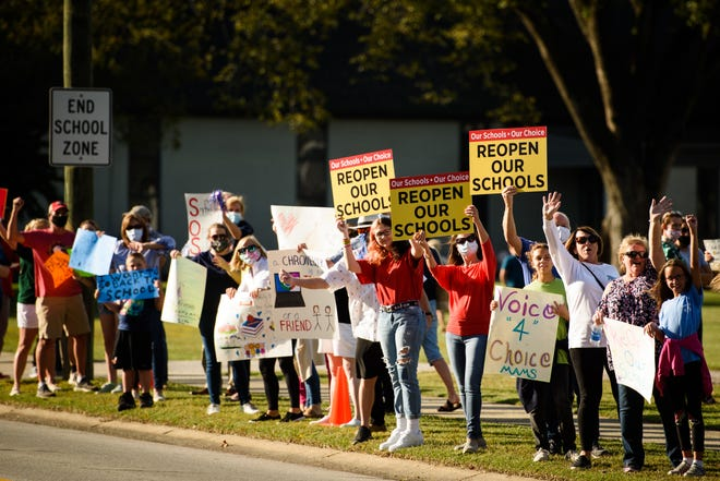 People attend a rally in support of reopening Cumberland County schools on Wednesday, Sept. 23, 2020.