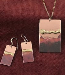 """November Sky Jewelry"" by Morningstar Metalworks will be on display at Malgorzata's Gallery through October."